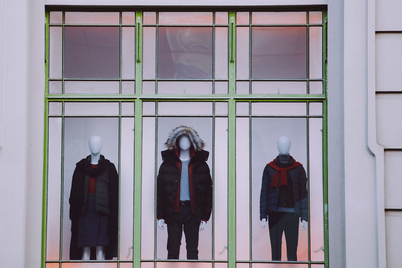 Three mannequins with clothes in storefront window closeup Fashion Mannequin Melbourne City Architecture Building Building Exterior Built Structure Clothes Clothing Day Glass - Material Human Representation Mannequin Melbourne Men Outdoors People Real People Rear View Reflection Representation Retail Display Standing Storefront Transparent Uniform Window