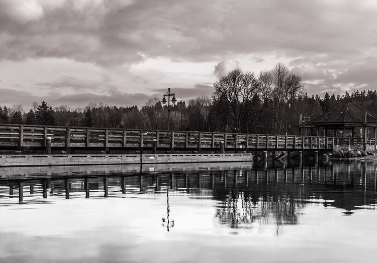 #B&W #beautifulbc #sunset #sun #clouds #skylovers #sky #nature #beautifulinnature #naturalbeauty #photography #landscape Architecture Beauty In Nature Bridge - Man Made Structure Built Structure Cloud - Sky Day Nature No People Outdoors Reflection River Sky SupernaturalBC Tree Water Waterfront
