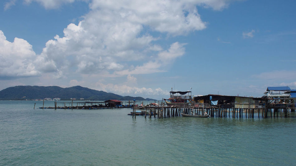 Tranquility view of blue ocean and blue sky on Pangkor Island, Malaysia Holiday Jet Boat Nature Ocean View Pangkor Island Beach Beauty In Nature Blue Blue Sky Blue Sky And Clouds Cloud - Sky Clouds And Sky Day Mountain Nature Nature_collection Ocean Outdoors Sand Sea Sky Stilt House Water Waterfront