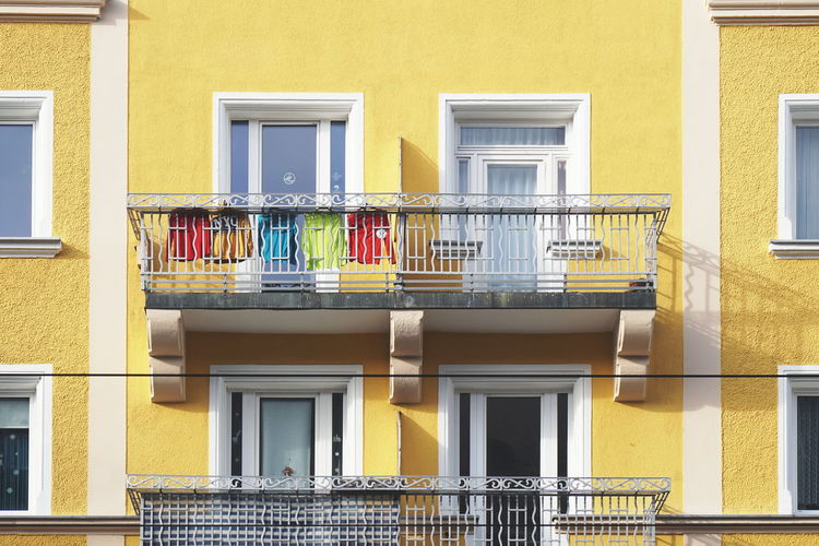 Architecture Built Structure Window Building Exterior Building Balcony Yellow Multi Colored Façade Colors