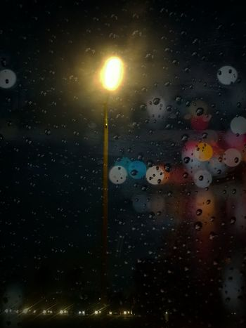 Streetlight in the rain... Night Backgrounds Drop Streetlight Bokeh Light Illuminated Multi Colored Water Nature Outdoors Full Frame EyeEm Best Shots Eye4photography  Nightphotography Darkness And Light Rainy Days Autumn Light In The Darkness View Out Of The Window
