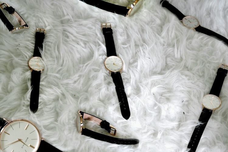 High angle view of wristwatches on fur