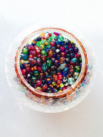 An abundance of colorful beads! Multi Colored Variety Bowl Variation White Background Colorful Beads Glass Bowl Amalgamation Circular Beautiful Color