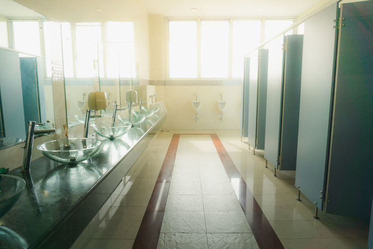 Man Toilet Absence Architecture Day Domestic Room Empty Flooring Glass - Material Home Household Equipment Indoors  Light And Shadow Luxury Modern Nature No People Sunlight Table Tiled Floor Transparent Window