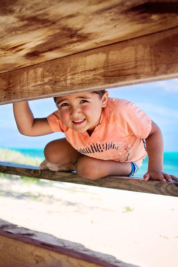 Portrait of happy boy on wood