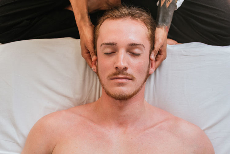 Therapist massaging customer in spa
