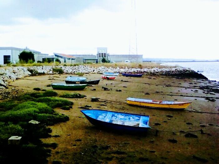 Waitiing For The Tide... Water Nautical Vessel Beach Sand Sea Day No People Tranquility Moored Nature Outdoors Low Tide Sky The Great Outdoors - 2017 EyeEm Awards Full Frame Portugal Travel Photography Figueiradafoz The Street Photographer - 2017 EyeEm Awards Street Photography The Photojournalist - 2017 EyeEm Awards Travel Destinations Streetphotography EyeEmNewHere