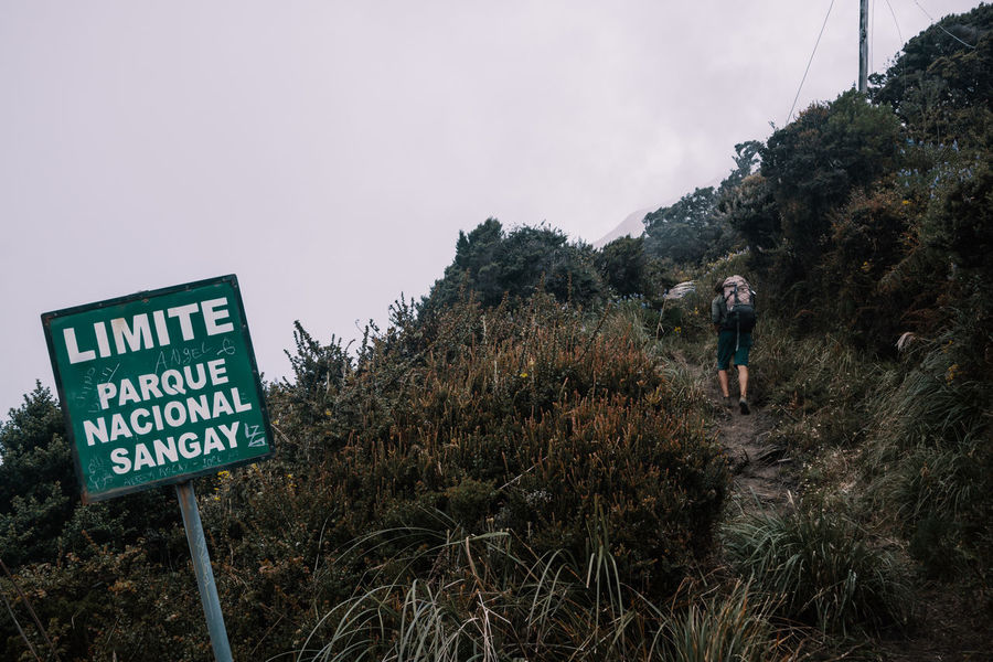 Day 1 - we're almost at the Refuge. Nature Outdoors Travel Destinations Explore Discover  Adventure Tungurahua Hiking South America Latin America Remote Non-urban Scene Plant Sky Mountain Text Real People Communication Leisure Activity Information Grass Lifestyles Activity One Person Sign