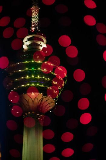 Black Background Celebration Christmas Christmas Decoration Christmas Ornament Cityscape Close-up Colored Background Illuminated Kuala Lumpur Tower Night Lights No People Red Shiny Studio Shot