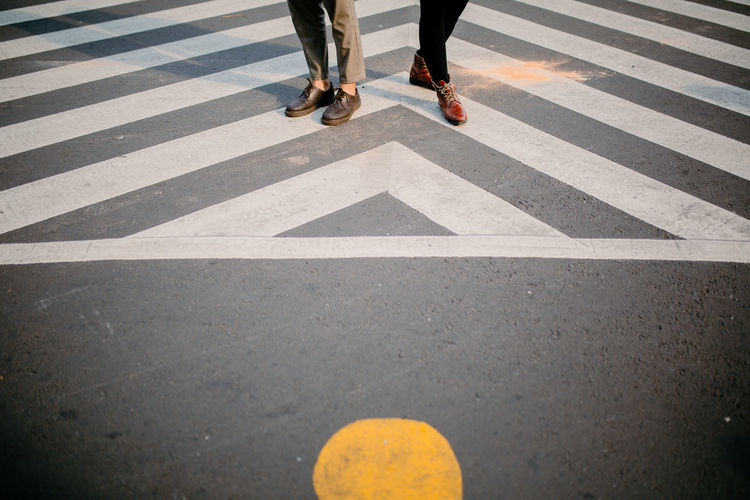 Low section of people crossing road