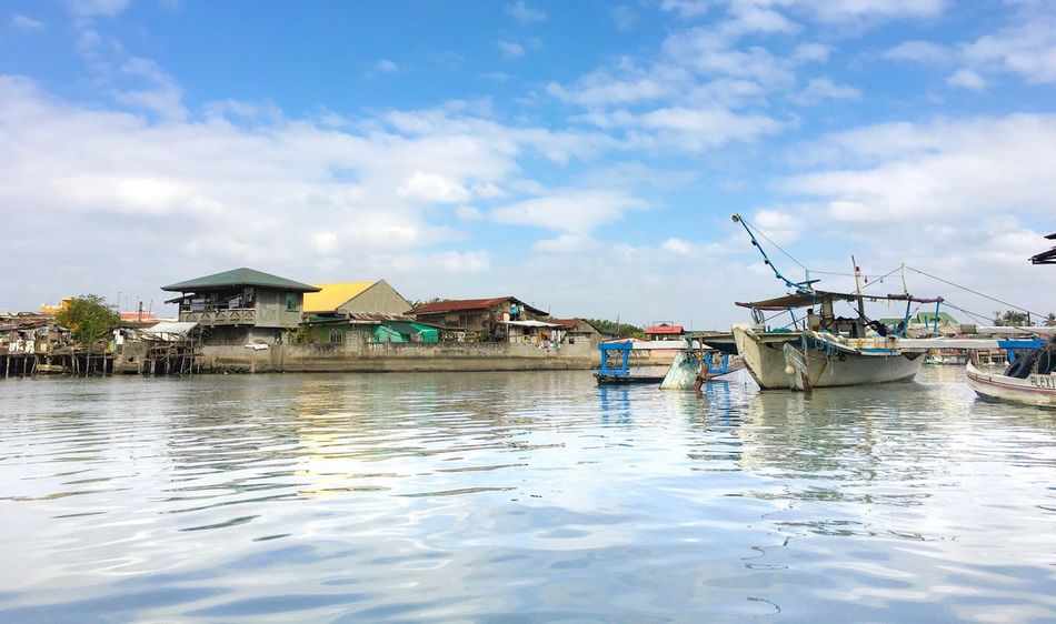 Life in Navotas Sky Water Nautical Vessel Cloud - Sky Transportation Mode Of Transport Day Outdoors Waterfront Built Structure Architecture Nature Tranquility Moored No People Sea Beauty In Nature
