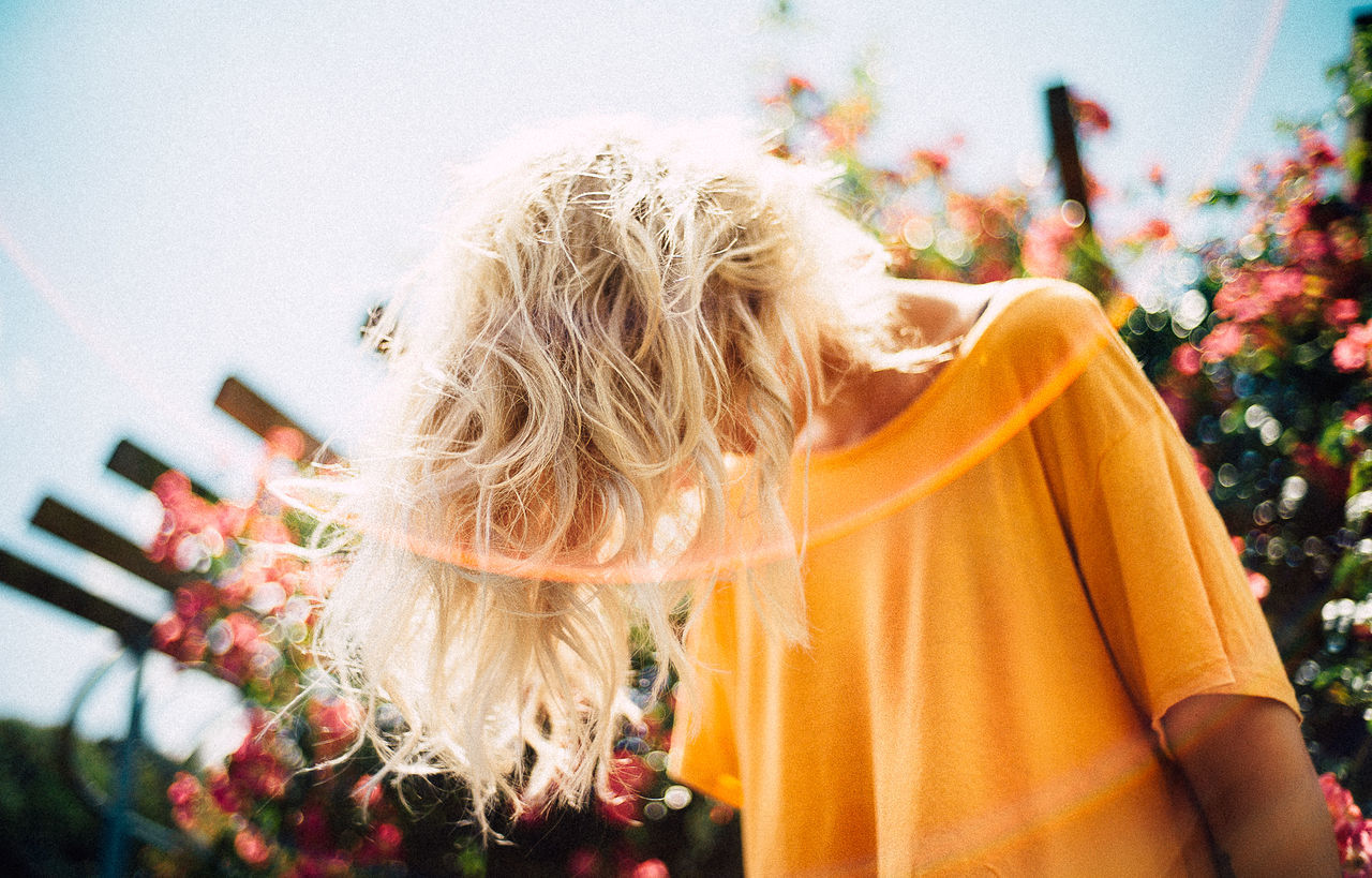 Low angle view of woman with blond hair