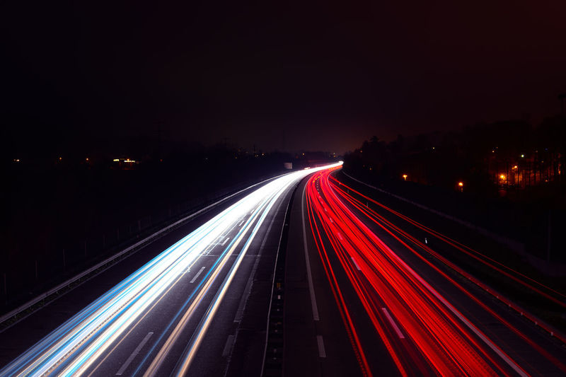 Illuminated Motion Long Exposure Transportation Light Trail Night Speed Road Blurred Motion Traffic Highway City Red Tail Light Street City Life Architecture Headlight Lighting Equipment Mode Of Transportation No People The Way Forward Multiple Lane Highway Outdoors Vehicle Light