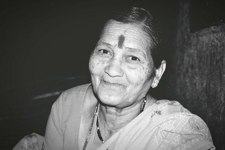 Portrait Of Mature Woman Sitting At Home