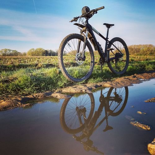 Sunday Ride Reflection Adventure Exploring MTB Water Lake Bicycle Reflection Sky Puddle Countryside Mountain Bike Cycling Stationary Calm Agricultural Field