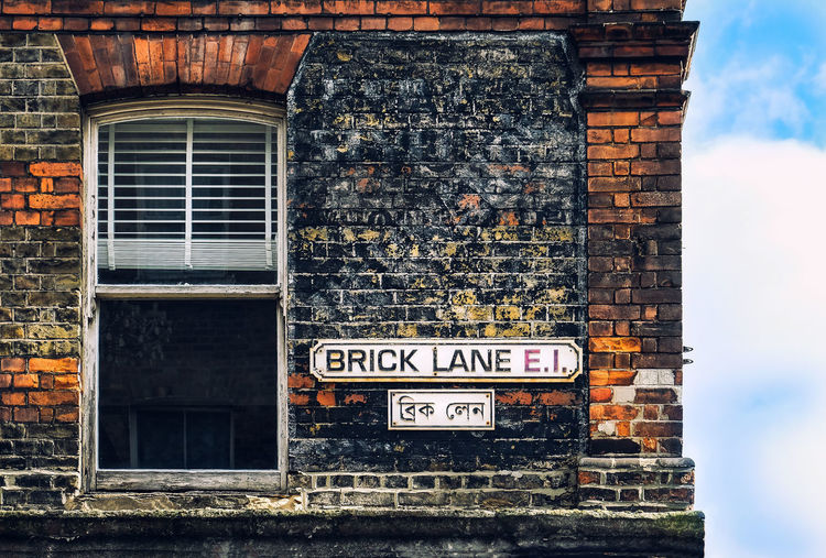 Brick lane vintage street sign with house window and red brick wall Text Architecture Built Structure Communication Building Exterior Western Script Building Information Sign Brick Wall Wall - Building Feature Outdoors Information No People Window Brick Old Wall House Sign London United Kingdom Brick Lane Brick Wall Retro Styled Vintage