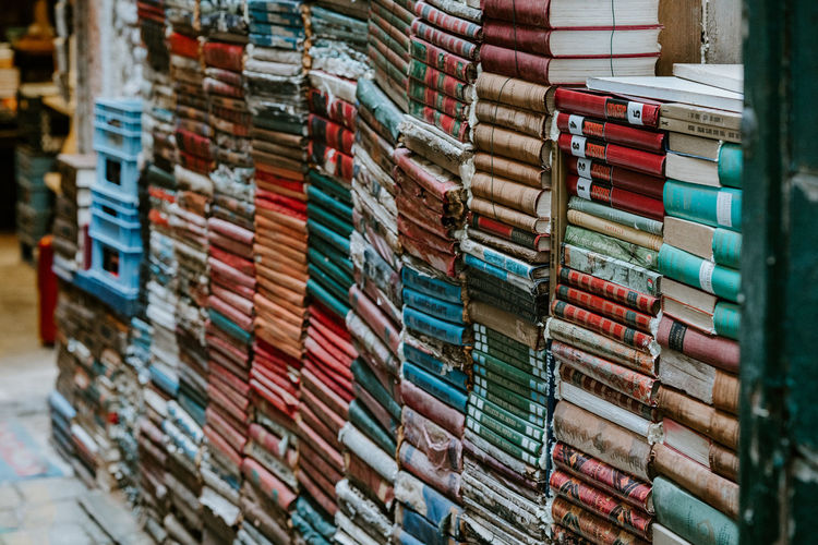 Piles of old, worn books Books Abundance Arrangement Book Business Choice Close-up Focus On Foreground Full Frame In A Row Indoors  Industry Large Group Of Objects Literacy Literature Multi Colored No People Order Retail  Selective Focus Shelf Stack Variation