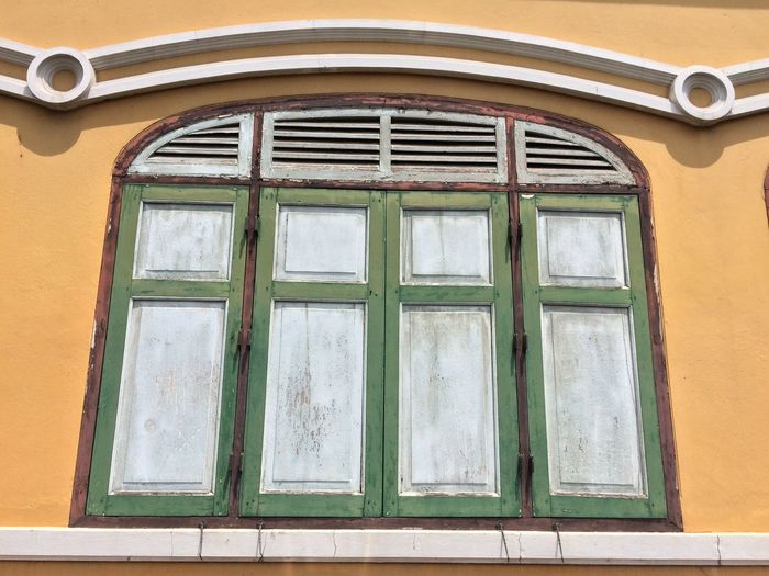 Window Built Structure Architecture Building Exterior Building No People Day Glass - Material Wall - Building Feature House Low Angle View Outdoors Residential District Green Color Window Frame Wood - Material Pattern Closed Shape Old Safety