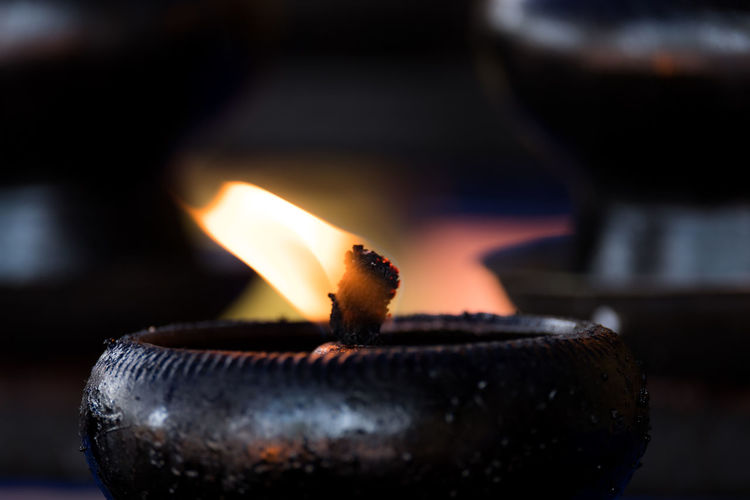 Burning Candle Close-up Day Diya - Oil Lamp Fire - Natural Phenomenon Flame Focus On Foreground Glowing Heat - Temperature Indoors  No People