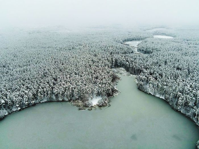 Frozen lake against sky during winter