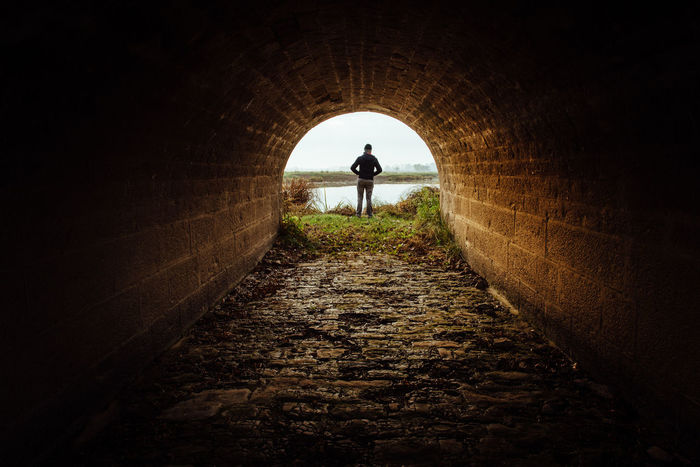 Hope Waiting Adult Arch Architecture Built Structure Day Full Length Indoors  Leisure Activity Lifestyles Light At The End Of The Tunnel Men Nature Nightmare One Person People Real People Rear View Silhouette Standing The Way Forward Tunnel Under Walking Be. Ready.