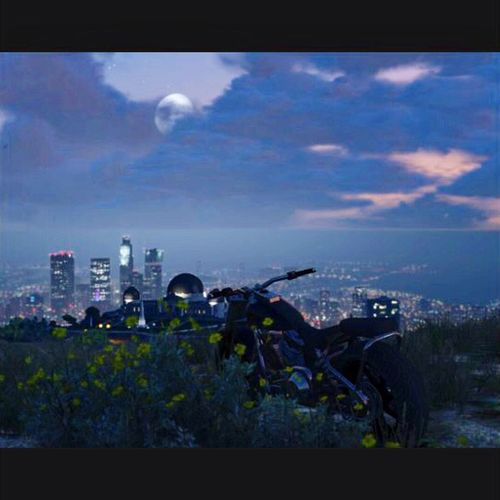 Taken by the phone in GTAV Snapmatic lol. GTAV Vinewood Snapmatic Building Exterior Built Structure Sky Cloud - Sky Architecture Transportation Nature No People Cityscape Outdoors Building Mode Of Transportation City Air Vehicle Day Blue Plant Moon Sea Water