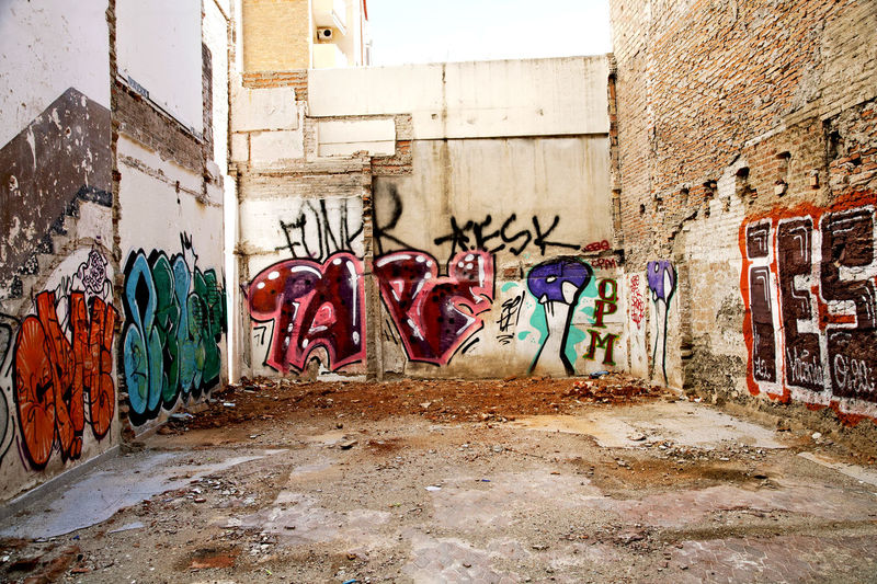 Empty plot of land, Barcelona, Spain. Building Site City Day Empty Graffiti Horizontal Investment Landscape Multi Colored No People Outdoors Plot Of Land Real Estate Space Spray Paint Street Art Urban Wall - Building Feature Walls