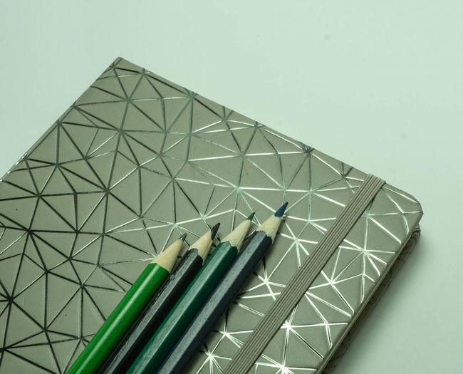 Close-up of pencils against white background
