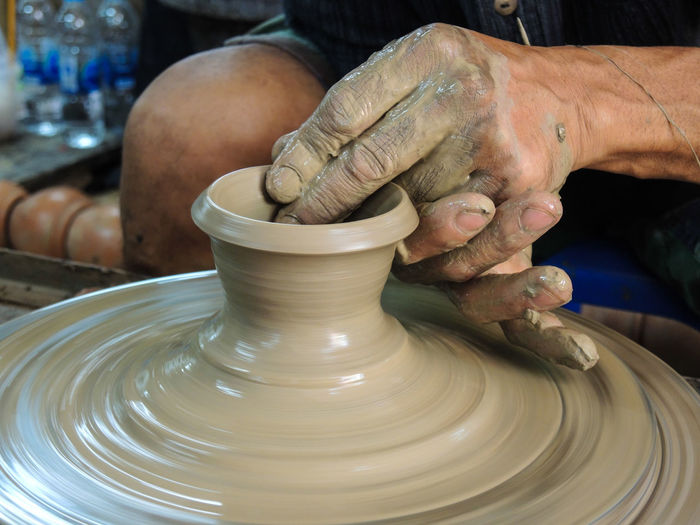 Close-Up Of Man Making Pot