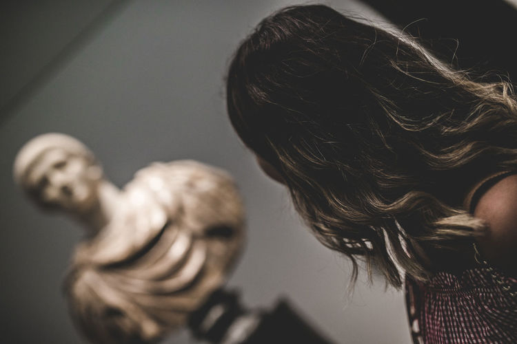 Woman by bust at museum