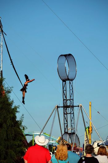 Nebraska State Fair August 2016 Grand Island, Nebraska -- Flippin' - A Steam Punk Theme Aerial & Acrobatic Spectactular Acrobat Acrobatics  Action Shot  Americans Arts Culture And Entertainment Balancing Act Bungee Camera Work Check This Out Clear Sky Daredevil Day EyeEm Gallery Fairground Flying Mid-air Nebraska Performing Arts Photography Photojournalism Sky State Fair Steam Punk Stunts Trapeze Artist