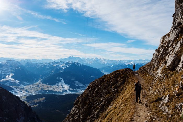 Hikers delight on a beautiful winter day in Austria EyeEm Selects Mountain Snow Winter Mountain Range Cold Temperature One Person Nature Beauty In Nature Scenics Sky Adventure Day Rear View Leisure Activity Real People Outdoors Snowcapped Mountain Cloud - Sky Landscape