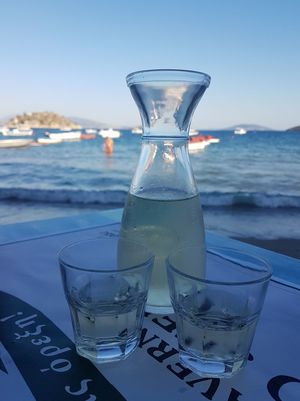 Greek hospitality by the sea with tasty wine. Beach Blue Champagne Close-up Day Drink Drinking Glass Focus On Foreground Food And Drink Freshness Greece Horizon Over Water Nature No People Outdoors Refreshment Sand Sea Shore Sky Table Transportation Water Waves Wine