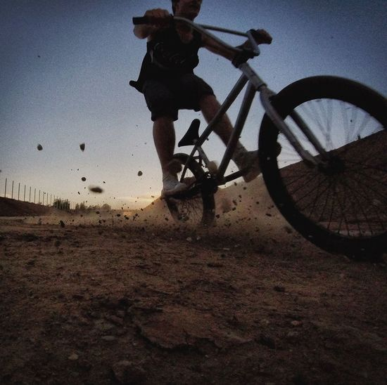 Enjoy The New Normal Real People Mid-air Bicycle Lifestyles Riding Leisure Activity Sport Full Length Stunt One Person Men Mode Of Transport Motion Extreme Sports Cycling Outdoors Sky Bmx Cycling Jumping Sunset