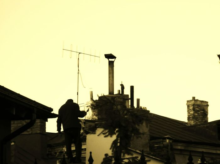 Bussiness as usual - The man on the rooftop - Architecture Built Structure Building Exterior Outdoors Man On Rooftop Silhouette The Week On EyeEm EyeEmNewHere Mix Yourself A Good Time Paint The Town Yellow