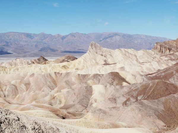 Zabriskie point Zabriskie Point Death Valley Tranquil Scene Scenics Nature Tranquility Geology Beauty In Nature Non-urban Scene Landscape Physical Geography Desert Arid Climate Remote Extreme Terrain Travel Destinations Day Idyllic Outdoors No People Sky Mountain Finding New Frontiers Miles Away
