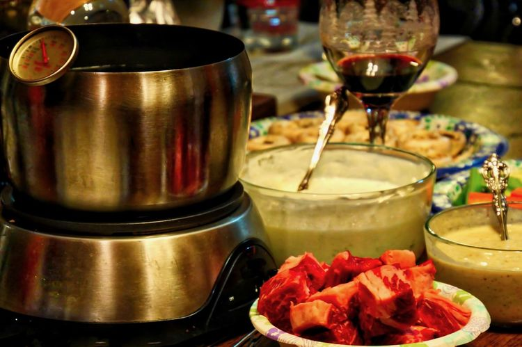 Fondue dinner set up and ready to eat. Dinner Mushrooms Red Wine Table Wine Wine Glass Batter Close-up Day Drink Filling Fondue Fondue Pot Food Food And Drink Freshness Indoors  Meat Thermometer No People Preparation  Refreshment Steak Table Thermometer Vegetables Wine Food Stories