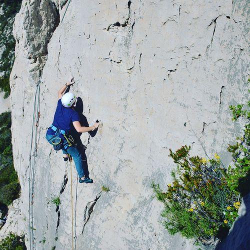 High Angle View Of Man Climbing On Rocky Mountain