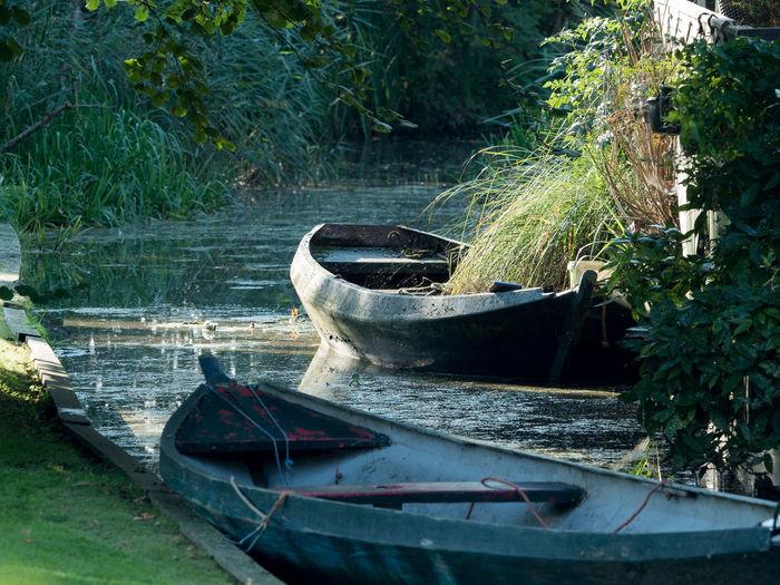 Boats moored at river