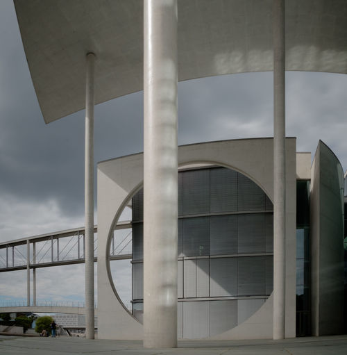Modern bridge against sky seen through glass window