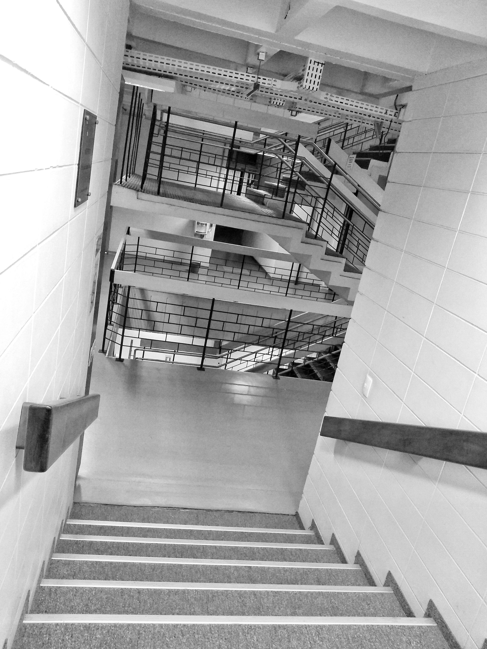 architecture, staircase, built structure, steps and staircases, building exterior, railing, the way forward, direction, building, no people, low angle view, day, empty, outdoors, absence, modern, tile, flooring, tiled floor, luxury