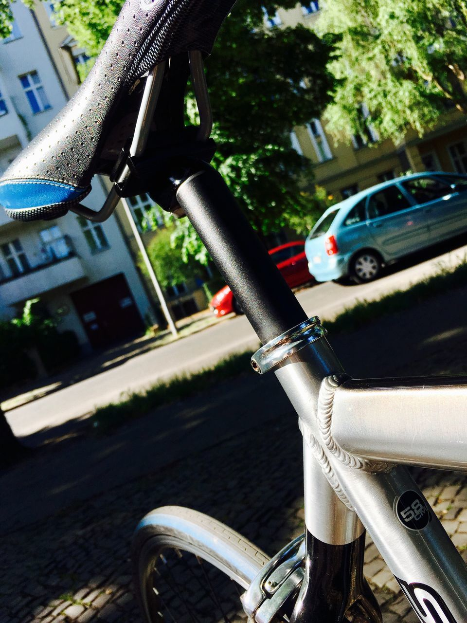 mode of transport, transportation, land vehicle, handlebar, car, bicycle, day, metal, outdoors, stationary, focus on foreground, close-up, no people, tree