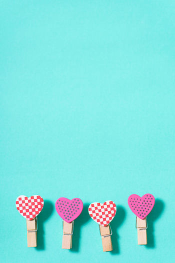 Close-up of heart shapes on turquoise background