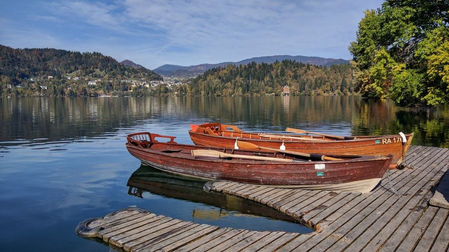 Blejsko Jezero / Lake Bled Nautical Vessel Water Reflection Lake Moored Outdoors Wood - Material Landscape No People Wooden Raft Tranquility Day Rowboat Tree Scenics Nature Sky Slovenia Lakeside Bled, Slovenia Lake View Bled Lake Slovenia Beauty In Nature Vacations