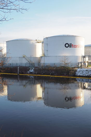 Architecture Built Structure Canal Ecology Energy Fossil Energy Fuel Nature Oil Oil Tank Outdoors Reflection River Stocked Water