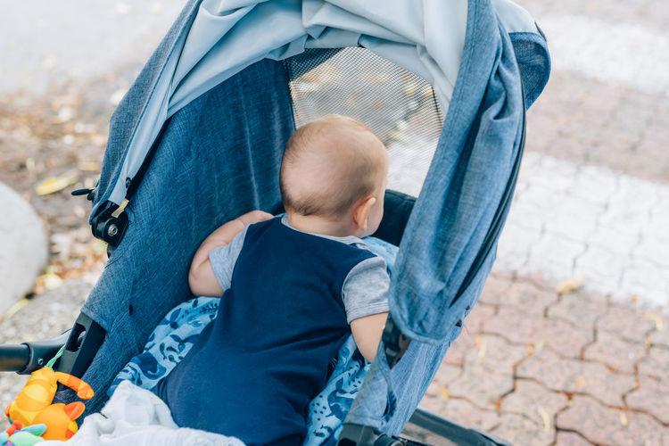 Rear view of baby boy in stroller