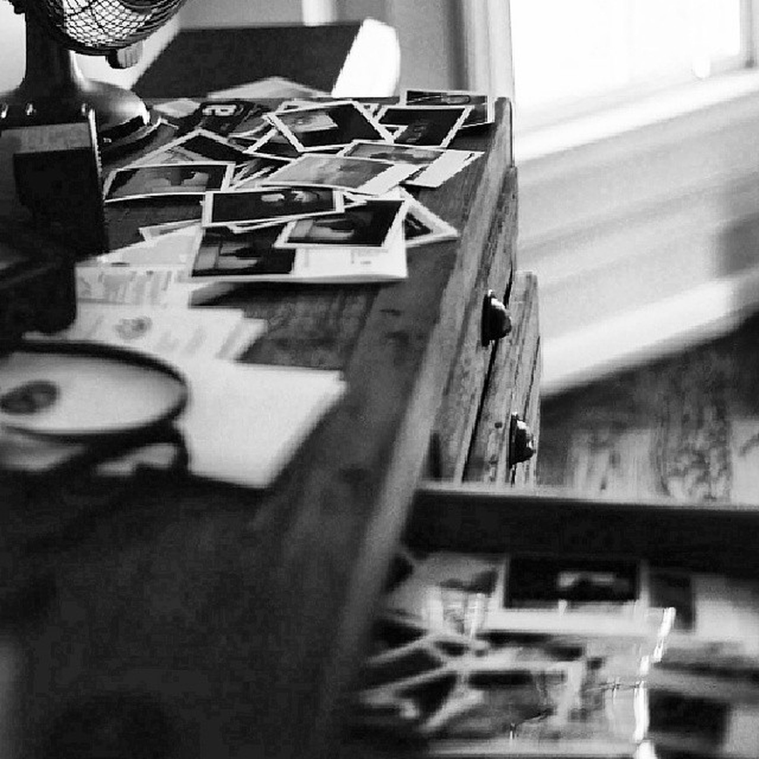 indoors, focus on foreground, table, selective focus, holding, close-up, part of, men, book, wood - material, communication, cropped, person, chair, day, working, home interior