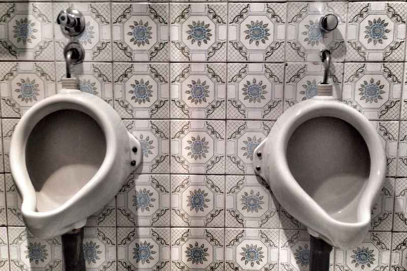 Public restroom with floral tile pattern