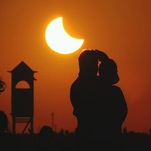 Love Silhouette Sunset Orange Color Architecture Sun Built Structure People Outdoors Sky Nature Day Love Eclipse Reflection Protection City