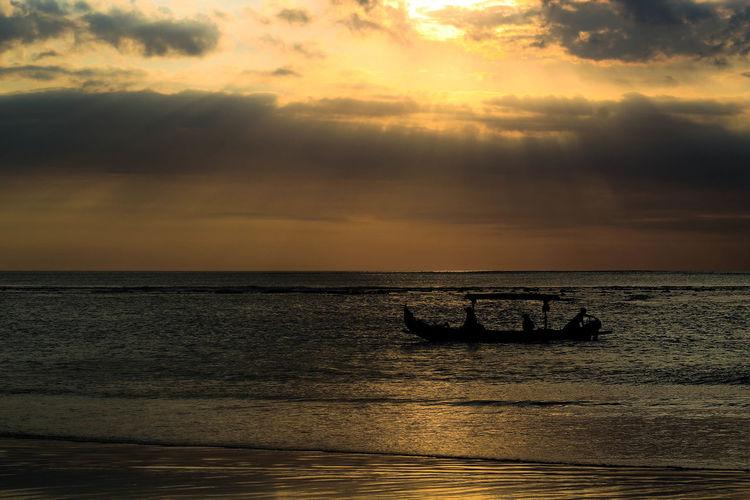 Silhouette Boat Water Low Tide Sea Sunset Beach Sunlight Wave Sun Awe Silhouette Tide Seascape Romantic Sky Horizon Over Water Dramatic Sky Sky Only Moody Sky Coast Surf Headland Salt Basin Rocky Coastline